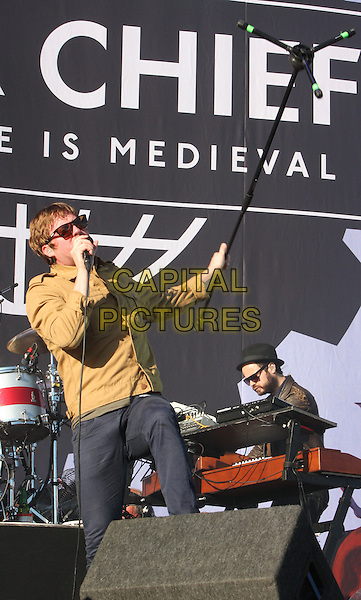 Ricky Wilson of Kaiser Chiefs .Performing live at V festival, Chelmsford, Essex, England, UK, August 20th 2011..music concert gig live on stage half length tambourine mustard shirt sunglasses jacket denim holding mic stand microphone singing .CAP/ROS.©Steve Ross/Capital Pictures.