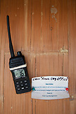 "EXUMA, Bahamas. A walkie talkie and a ""out of the office"" sign on the office door of the Fowl Cay Resort."