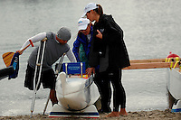 Carlito Butalip checks a fellow athlete's  adapted chair ready for a paddle on Mission Bay in an outrigger canoe with instructors Cheance Adair (c) and Nicole Holbrook during an event sponsored by the Challenged Athletes Foundation on Saturday, January 24th 2009.  The participants had the opportunity to  try several different paddle sports. The Challenged Athletes Foundation established the Operation Rebound fund to provide sports opportunities and support for troops, veterans and first responders who have suffered permanent physical injuries in the line of duty.