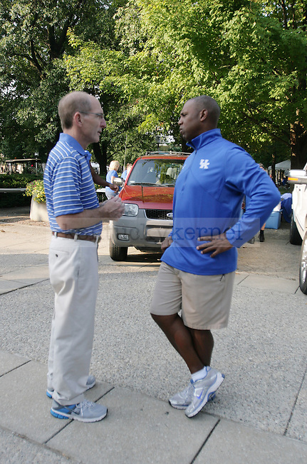 UK President Eli Capilouto and UK football head coach Joker Phillips talk in between helping students move in on South Campus on Friday, Aug. 19, 2011, in Lexington, Ky. Photo by Becca Clemons | STAFF