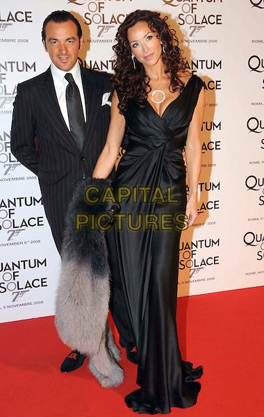 "GUEST & SOFIA MILOS.""Quantum of Solace"" Rome Premiere held at the Warner Village Moderno Cinema, Rome Italy..November 5th, 2008.full length black dress silk satin.CAP/ADM/Liverani/MB.©Massimo Bruni/Liverani/AdMedia/Capital Pictures"