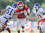 SIOUX FALLS, SD - SEPTEMBER 7:  Caden Quintanilla #25 from Lincoln busts past Jake Neidringhaus #51 from O'Gorman in the third quarter of their game at the 2013 Presidents Bowl at Howard Wood Field. (Photo by Dave Eggen/Inertia)