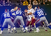 Washington Redskins quarterback Brad Johnson (14) looks for a receiver as New York Giants linebacker Jessie Armstead (98), defensive tackle Cornelius Griffin (97) and defensive back Sam Garnes (20) provide the pass rush during the game at Giants Stadium in East Rutherford, New Jersey on September 24, 2000.  The Redskins won the game 16 - 6.<br /> Credit: Arnie Sachs / CNP