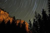 Star tracks on Sky and rock formation, Cheile Bicazului-Hasmas National Park, Carpathians, Transylvania, Romania,
