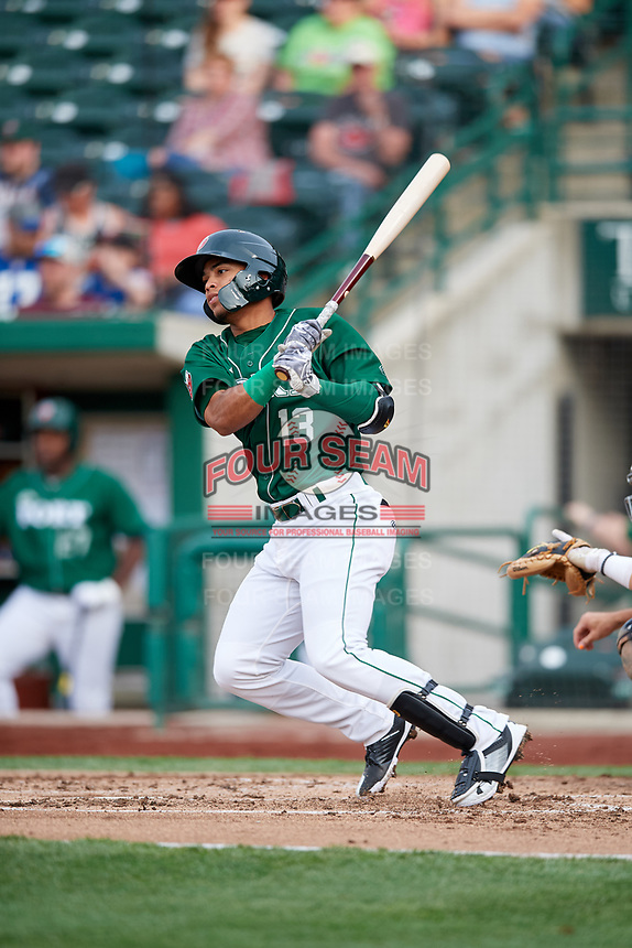 Fort Wayne TinCaps third baseman Luis Almanzar (13) hits a single during a game against the West Michigan Whitecaps on May 17, 2018 at Parkview Field in Fort Wayne, Indiana.  Fort Wayne defeated West Michigan 7-3.  (Mike Janes/Four Seam Images)