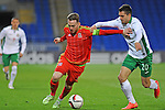 UEFA Under 21 Championship Qualifier - Wales v Bulgaria at the Cardiff City Stadium, UK :<br /> Wales Under 21 Captain Gethin Jones fends off the tackle of Lazar Marin of Bulgaria Under 21's.