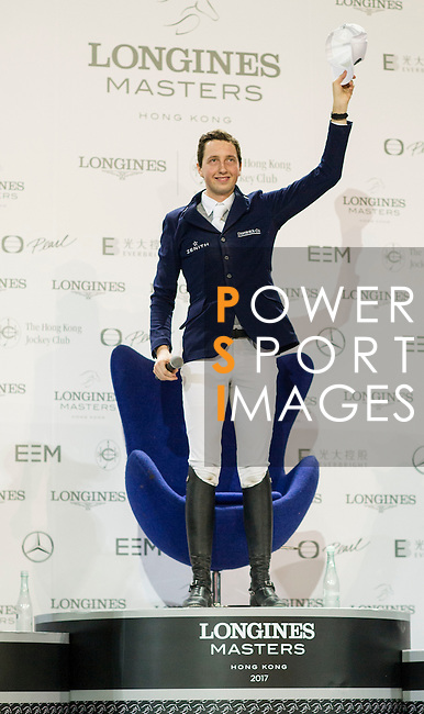 Martin Fuchs of Switzerland wins the Hong Kong Jockey Club Trophy competition, part of the Longines Masters of Hong Kong on 10 February 2017 at the Asia World Expo in Hong Kong, China. Photo by Juan Serrano / Power Sport Images
