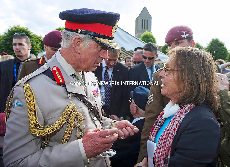 05.06.2014; Normandy, FRANCE: PRINCE CHARLES<br /> meeting french civilians in Breville-les-Monts.<br /> He attended a parade in Breville-les-Monts after watching Parachutists landing on a Drop Zone as part of the D-Day remembrance services.<br /> The Prince of Wales is Colonel in Chief of The Parachute Regiment.<br /> Mandatory Credit Photo: &copy;Peters-Crown Copyright/NEWSPIX INTERNATIONAL<br /> <br /> **ALL FEES PAYABLE TO: &quot;NEWSPIX INTERNATIONAL&quot;**<br /> <br /> IMMEDIATE CONFIRMATION OF USAGE REQUIRED:<br /> Newspix International, 31 Chinnery Hill, Bishop's Stortford, ENGLAND CM23 3PS<br /> Tel:+441279 324672  ; Fax: +441279656877<br /> Mobile:  07775681153<br /> e-mail: info@newspixinternational.co.uk