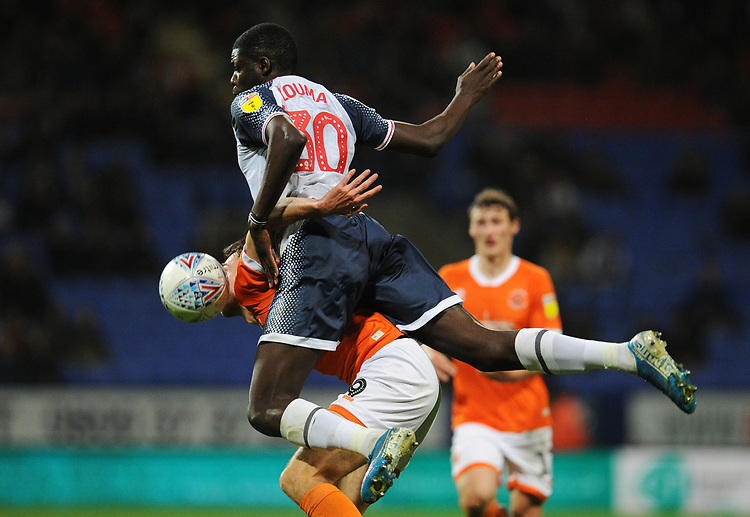 Blackpool's Ryan Hardie vies for possession with Bolton Wanderers' Yoan Zouma<br /> <br /> Photographer Kevin Barnes/CameraSport<br /> <br /> The EFL Sky Bet League One - Bolton Wanderers v Blackpool - Monday 7th October 2019 - University of Bolton Stadium - Bolton<br /> <br /> World Copyright © 2019 CameraSport. All rights reserved. 43 Linden Ave. Countesthorpe. Leicester. England. LE8 5PG - Tel: +44 (0) 116 277 4147 - admin@camerasport.com - www.camerasport.com