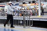 Osaka, JP - January 21, 2015 : A man cleans the safety bars at the trains platform in Shin Osaka station. (Photo by Rodrigo Reyes Marin/AFLO)