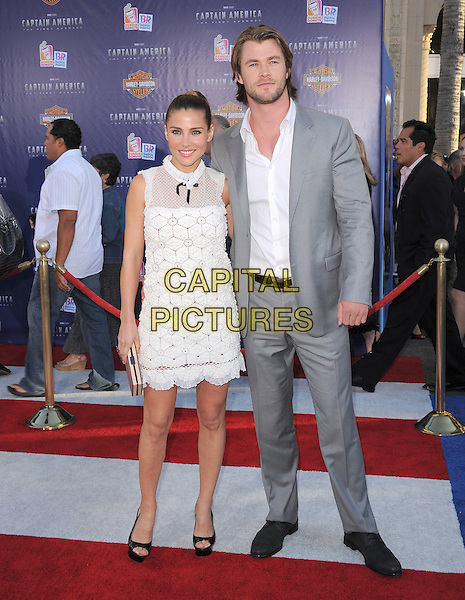 "Elsa Pataky & Chris Hemsworth.Premiere of ""Captain America: The First Avenger"" held at The El Capitan Theatre in Hollywood, California, USA..July 19th, 2011                                                                                .full length dress platform open toe shoes  white sheer crochet black bow sleeveless hair up shirt grey gray suit married husband wife.CAP/RKE/DVS.©DVS/RockinExposures/Capital Pictures."