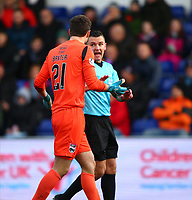 1st December 2019; Global Energy Stadium, Dingwall, Highland, Scotland; Scottish Premiership Football, Ross County versus Celtic; Nathan Baxter of Ross County argues with referee Nick Walsh after the penalty is awarded against them - Editorial Use