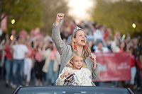 NWA Democrat-Gazette/ANDY SHUPE<br /> Megan Godfrey, the 2004 University of Arkansas homecoming queen, calls the Hogs Friday, Nov. 1, 2019, with her daughter, Zuzu Godfrey, during the university's annual homecoming parade on Dickson Street in Fayetteville. The Razorbacks football team hosts Mississippi State at 3 p.m. today. Visit nwadg.com/photos to see more photographs from the parade.