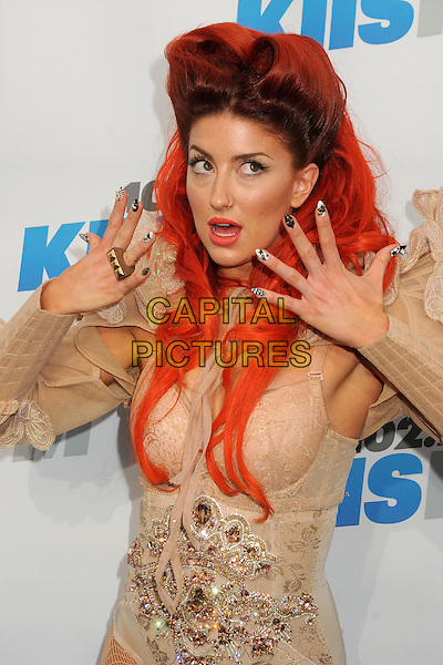 Neon Hitch.KIIS FMs Wango Tango 2012 held at the Home Depot Center, Carson, California, USA..May 12th, 2012.half length embellished jewel encrusted  dyed red orange hair pink gold fashion floral flowers white silver shoulder frills butterfly butterflies  dyed red orange hair mouth open hands nail varnish polish black white ring.CAP/ADM/BP.©Byron Purvis/AdMedia/Capital Pictures.