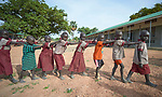 Students walk in a line at the Loreto Primary School in Rumbek, South Sudan. While focused on educating girls from throughout the war-torn country, the school, run by the Institute for the Blessed Virgin Mary--the Loreto Sisters--of Ireland, also educates children from nearby communities.