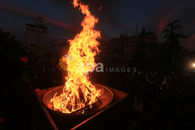 Palestinian supporters of the Fatah movement take part during a rally marking the fifty-four anniversary of the creation of the political party, in Gaza city on December 31, 2018. Photo by Mahmoud Khattab
