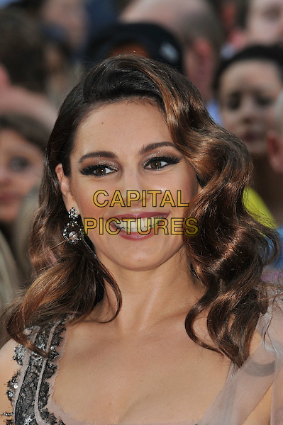 Kelly Brook.World Premiere of 'Keith Lemon: The Film' at the Odeon West End, Leicester Square, London, England..August 20th 2012.headshot portrait silver beige smiling .CAP/BF.©Bob Fidgeon/Capital Pictures.