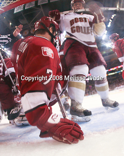 Nate Gerbe (BC 9) sends Chad Morin (Harvard 7) into the Harvard net. The Boston College Eagles defeated the Harvard University Crimson 6-5 in overtime on Monday, February 11, 2008, to win the 2008 Beanpot at the TD Banknorth Garden in Boston, Massachusetts.
