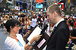As The World Turns' Colleen Zenk is ordained Universal Life Church minister who officiated the wedding of We Love Soaps Roger Newcomb on August 18, 2012 in Times Square, New York City, New York. (Photos by Sue Coflin/Max Photos)