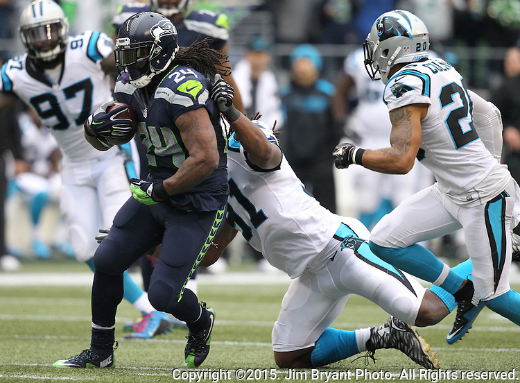 Seattle Seahawks  running back Marshawn Lynch (24) is grabbed by Carolina Panthers defensive end Ryan Delaire (91) and safety Kurt Coleman (20) at CenturyLink Field in Seattle on October 18, 2015. The Panthers came from behind with 32 seconds remaining in the 4th Quarter to beat the Seahawks 27-23.  ©2015 Jim Bryant Photography. All Rights Reserved.