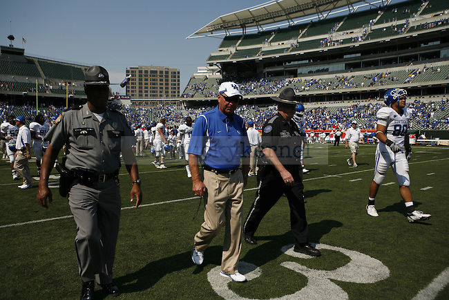 UK head coach Rich Brooks leaves the field of Paul Brown Stadium after the Cats defeated the Miami-Ohio Redhawks 42-0 on Saturday, Sept. 5, 2009. Photo by Allie Garza | Staff