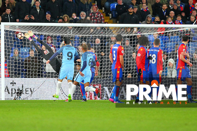 Crystal Palace goalkeeper Wayne Hennessey is unable to stop Manchester city's Yaya Toure from scoring the 3rd goal during the FA Cup fourth round match between Crystal Palace and Manchester City at Selhurst Park, London, England on 28 January 2017. Photo by PRiME Media Images / Steve McCarthy.