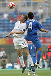07 August 2008: Brian McBride (USA) (17) and Hiroki Mizumoto (JPN) (4) challenge for a header.  The men's Olympic team of the United States defeated the men's Olympic soccer team of Japan 1-0 at Tianjin Olympic Center Stadium in Tianjin, China in a Group B round-robin match in the Men's Olympic Football competition.