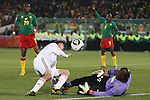 19 JUN 2010: Jon Dahl Tomasson (DEN) (9) and Souleymanou Hamidou (CMR) (16). The Denmark National Team defeated the Cameroon National Team 2-1 at Loftus Versfeld Stadium in Tshwane/Pretoria, South Africa in a 2010 FIFA World Cup Group E match.