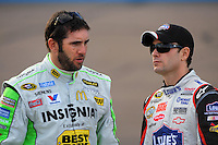 Nov. 13, 2009; Avondale, AZ, USA; NASCAR Sprint Cup Series driver Elliott Sadler (left) talks with Jimmie Johnson during qualifying for the Checker O'Reilly Auto Parts 500 at Phoenix International Raceway. Mandatory Credit: Mark J. Rebilas-
