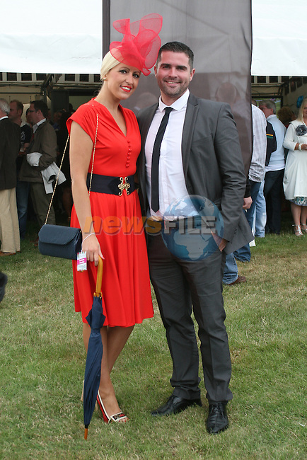 Winner of the Best Dressed Lady Competition, Lynn Keeley with her boyfriend and Best Dressed Man Finalist Ken Browne  at the Bellewstown Races...Photo NEWSFILE/Jenny Matthews.(Photo credit should read Jenny Matthews/NEWSFILE)....This Picture has been sent you under the condtions enclosed by:.Newsfile Ltd..The Studio,.Millmount Abbey,.Drogheda,.Co Meath..Ireland..Tel: +353(0)41-9871240.Fax: +353(0)41-9871260.GSM: +353(0)86-2500958.email: pictures@newsfile.ie.www.newsfile.ie.FTP: 193.120.102.198.