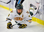 30 October 2010: University of Vermont Catamount defenseman Kyle Medvec, a Senior from Burnsville, MN, is upended during game action against the University of Maine Black Bears at Gutterson Fieldhouse in Burlington, Vermont. The Black Bears defeated the Catamounts 3-2 in sudden death overtime. Mandatory Credit: Ed Wolfstein Photo