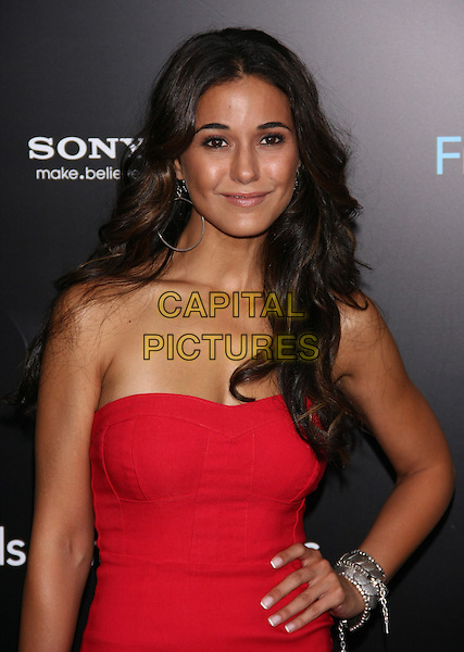 """Emmanuelle Chriqui.The New York Premiere of """"Friends With Benefits"""" at the Ziegfeld Theater, New York, NY, USA..July 18th, 2011.half length red strapless dress hand on hip gold bracelet .CAP/LNC/TOM.©LNC/Capital Pictures."""