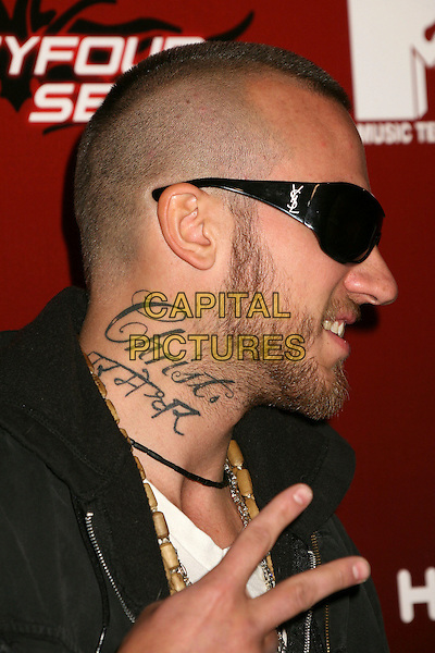 "CHRIS CARNEY .MTV Series Premiere of ""Twentyfourseven"" at Area, .Los Angeles, California, USA,.29 November 2006..portrait headshot sunglasses beard  fingers peace sign teeth tattoo on neck profile.CAP/ADM/BP.©Byron Purvis/AdMedia/Capital Pictures."