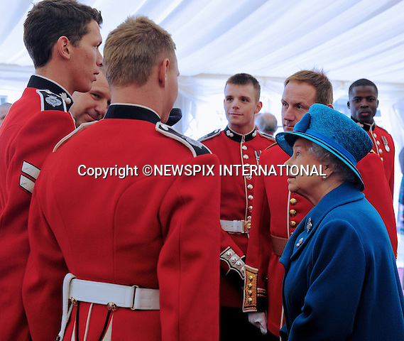 "QUEEN ELIZABETH.The Colonel in Chief, presents the new colours to The 1st Battalion Grenadier Guards, Buckingham Palace London..Photo Credit: ©Harmer_Newspix International..**ALL FEES PAYABLE TO: ""NEWSPIX INTERNATIONAL""**..PHOTO CREDIT MANDATORY!!: NEWSPIX INTERNATIONAL..IMMEDIATE CONFIRMATION OF USAGE REQUIRED:.Newspix International, 31 Chinnery Hill, Bishop's Stortford, ENGLAND CM23 3PS.Tel:+441279 324672  ; Fax: +441279656877.Mobile:  0777568 1153.e-mail: info@newspixinternational.co.uk"