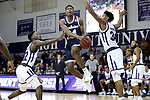 HIGH POINT, NC - JANUARY 06: Charleston Southern's Phlandrous Fleming, Jr. (24) is defended by High Point's Andre Fox (22) and Jordan Whitehead (34). The High Point University of Panthers hosted the Charleston Southern University Buccaneers on January 6, 2018 at Millis Athletic Convocation Center in High Point, NC in a Division I men's college basketball game. HPU won the game 80-59.