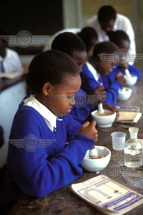 © Giacomo Pirozzi / Panos Pictures..KENYA..Chemistry class in a girls' school.