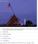 Iwo Jima Monument at dusk on the Arlington, Virginia side of the Potomac River, Washington DC in the background.