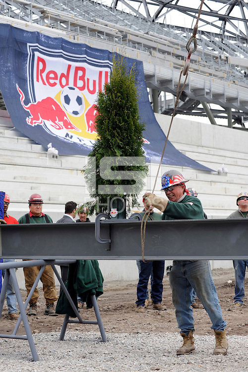 A steel worker readies the last piece of steel to be lifted into place during the topping off ceremony at Red Bull Arena in Harrison, NJ, on April 14, 2009.