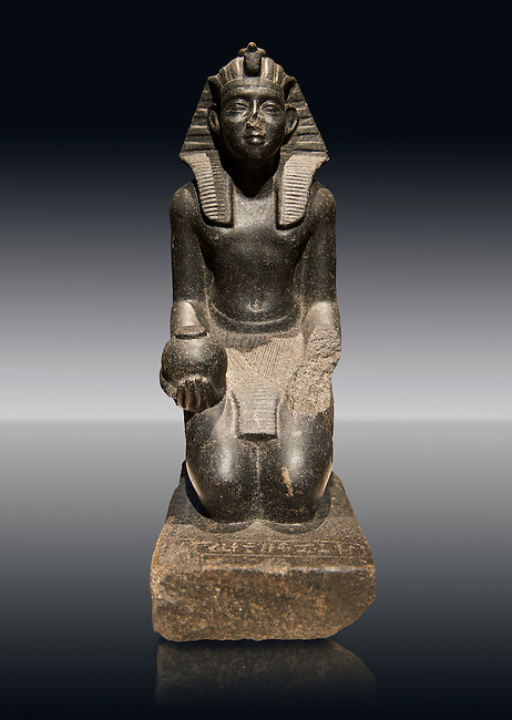 Ancient Egyptian granite sculpture of Pharaoh Sobekhotep V kneeling with an ointment vessel. 13-14 Dynasty Ancient Egypt, 1750-1700 BC . Neues Museum Berlin Cat No: AM 10645.