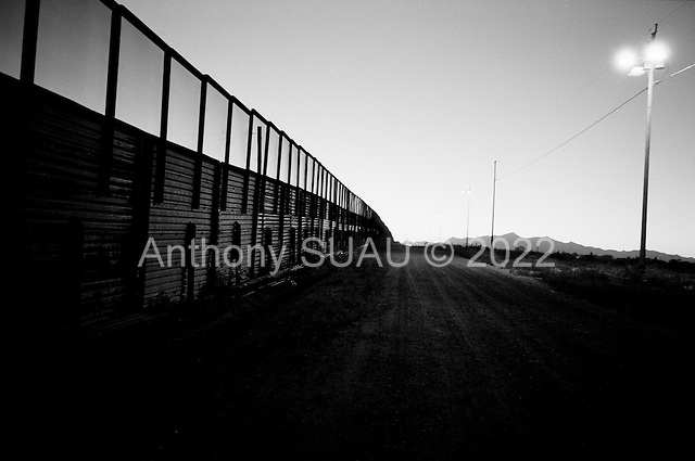Naco, Arizona.USA.October 21, 2006..Night falls on the fence to deter illegal immigration at this border crossing or port of entry. Thousands of illegal immigrates cross into the USA from in and around this town. The fence extends only a few feet in either direction from the port of entry. The towns' population is mainly Mexican - legal and illegal. .