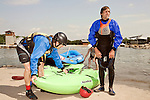 April 30, 2012. Charlotte, NC..Erik Weihenmayer, right, gets ready to get in his kayak for the first set of runs of the day. He will be accompanied by Rob Raker, who will help guide him though the rapids.. Erik Weihenmayer, who has been completely blind since age 13, is training at the United States National White Water Center in an attempt to kayak through the Grand Canyon. Weihenmayer is an accomplished outdoorsman who has climbed the 7 Summits, and is the only blind person to climb Mount Everest.