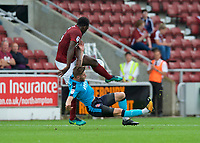 Wes Burns of Fleetwood Town is brought down by Aaron Pierre of Northampton Town during the Sky Bet League 1 match between Northampton Town and Fleetwood Town at Sixfields Stadium, Northampton, England on 12 August 2017. Photo by Alan  Stanford / PRiME Media Images.