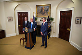 "United States President President J. Donald Trump makes an announcement on the introduction of the Reforming American Immigration for a Strong Economy (RAISE) Act with US Senator Tom Cotton (Republican of Arkansas), left, and US Senator David Perdue (Republican of Georgia), right, in the Roosevelt Room at the White House in Washington, D.C., U.S., on Wednesday, August 2, 2017. The act aims to overhaul U.S. immigration by moving towards a ""merit-based"" system.  <br /> Credit: Zach Gibson / Pool via CNP"