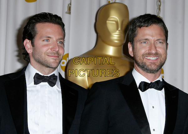 BRADLEY COOPER & GERARD BUTLER .The 82nd Annual Academy Awards held aat The Kodak Theatre in Hollywood, California, USA..March 7th, 2010.oscars half length black white tuxedo beard stubble facial hair   .CAP/EAST.©Eastman/Capital Pictures.