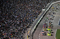 Nov. 6, 2009; Fort Worth, TX, USA; NASCAR Camping World Truck Series driver Matt Crafton (88) and Todd Bodine (30) lead the field at the green flag during the WinStar World Casino 350 at the Texas Motor Speedway. Mandatory Credit: Mark J. Rebilas-