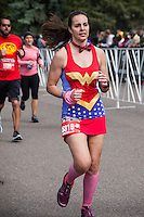 A half marathon participant in Wonder Woman costume at the 2016 Colfax Marathon in Denver, Colorado