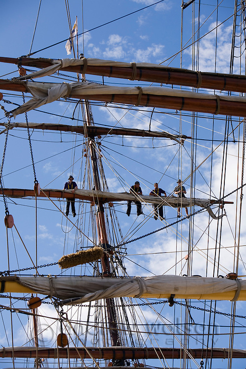 Sailors on the mast of a traditional sailing ship, during the Wooden Boat Festival.  The bi-annual festival draws wooden boat enthusiasts from around the world.  Hobart, Tasmania, Australia