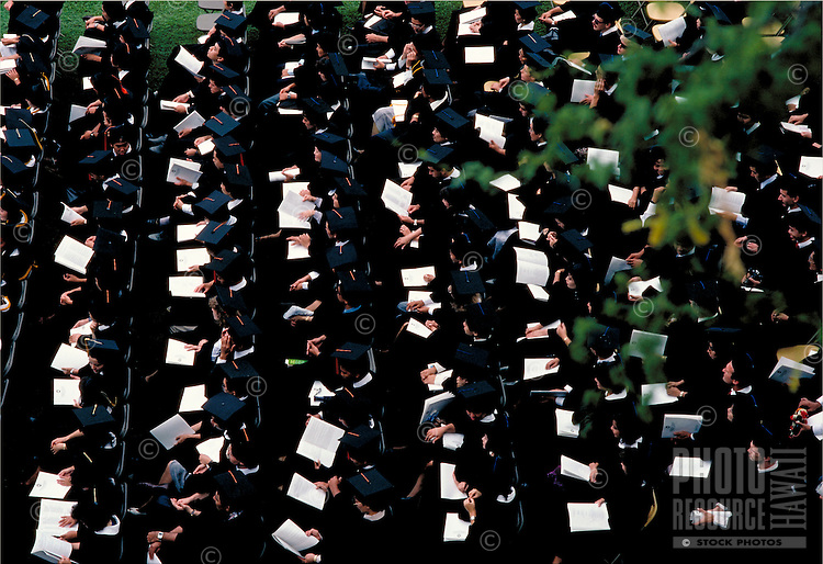 Top view of students in cap and gown at the University of Hawaii graduation program.