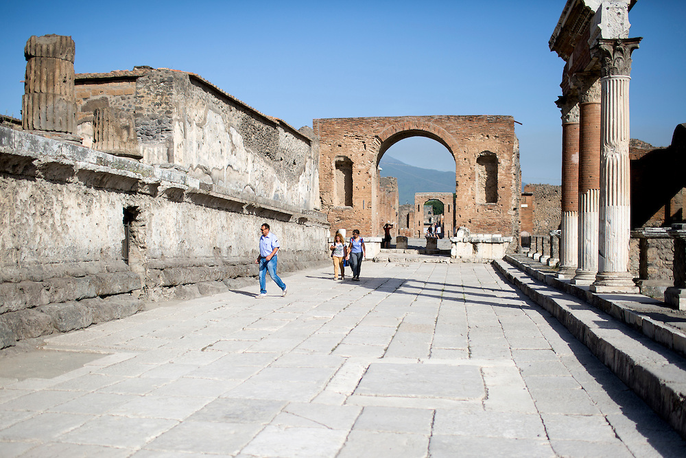 Tourists make their way past the Temple of Jupiter, at left, on Friday, Sept. 18, 2015, in Pompeii, Italy. The city of Pompeii was destroyed when nearby Mount Vesuvius erupted on August 24, AD 79. The town and its residents were buried and forgotten until the ruins were discovered and eventually excavated hundreds of years later. The ruins are one of Italy's top tourist attractions today. (Photo by James Brosher)