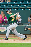 David Rohm (34) of the Lynchburg Hillcats follows through on his swing against the Winston-Salem Dash at BB&T Ballpark on August 5, 2013 in Winston-Salem, North Carolina.  The Dash defeated the Hillcats 5-0.  (Brian Westerholt/Four Seam Images)